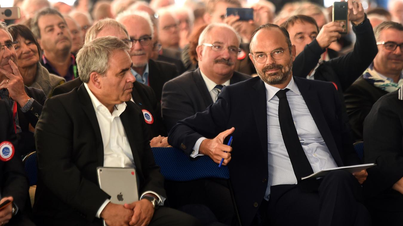 French Prime Minister Edouard Philippe (R) speaks with President of the Regional Council of the Hauts de France Xavier Bertrand (L) as they attend the Mayors' Congress, in Eppe-Sauvage, northern France, on September 20, 2019. (Photo by FRANCOIS LO PRESTI / AFP)