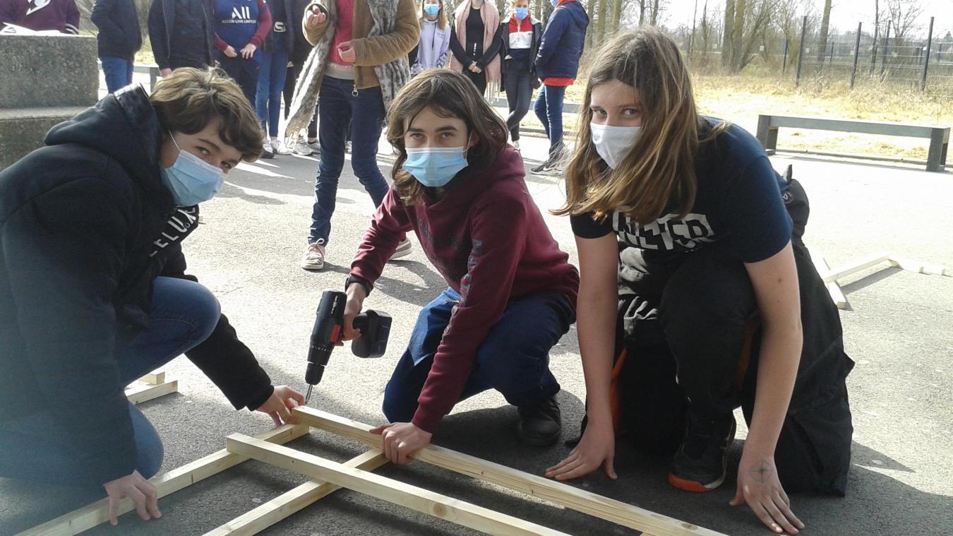 Parmi les acteurs du projet, les élèves de la classe d'excellence latin de d'Emmanuelle Mentel, Lucas, Titouan, Noam et Nathan (de gauche à droite).